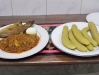 cooked plantain and fish with gravy